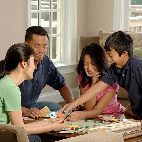 Family therapy. Family playing board game.